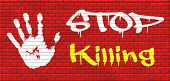 stock photo of kill  - stop killing no guns ban weapons end the war and violence graffiti on red brick wall - JPG