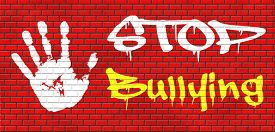 stock photo of school bullying  - stop bullying graffiti no bullies prevention against school work or in the cyber internet harassment graffiti on red brick wall - JPG