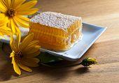 image of jerusalem artichokes  - honeycombs and flowers of Jerusalem artichoke on a wooden table - JPG