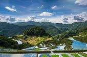 foto of ifugao  - Amazing panorama view of rice terraces fields in Ifugao province mountains under cloudy blue sky - JPG