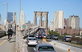 foto of brooklyn bridge  - cyclist beating a rush hour traffic jam over the brooklyn bridge - JPG
