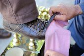 stock photo of insole  - Shoe cleaner working on the Streets of Istanbul - JPG