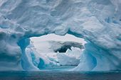 image of hollow log  - Large Arctic iceberg with a cavity inside - JPG