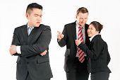 Business people (multi-ethnic) pointing their fingers on a colleague - mobbing