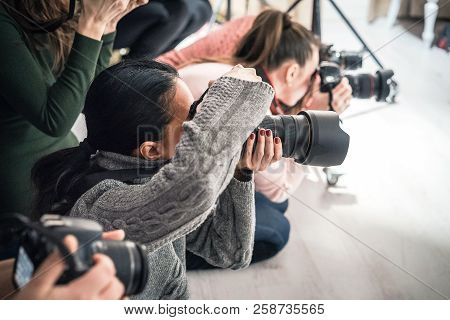 Photographer Is Taking Pictures With
