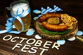October Fest Concept. Wooden Table In Pub Mug Pint Glass Cup Of Beer With Blue Tape, Snacks Chips, S poster