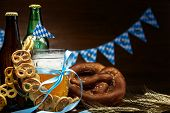 October Fest Concept. Wooden Table In Pub Mug Pint Glass Cup Of Beer With Blue Tape, Snacks, Chips,  poster