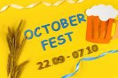 October Fest Concept. Wheat, Germany Beer And Blue Wooden Text october Fest 22.09 - 07.10 On Yello poster