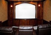 pic of home theater  - private home theater with screen and lounge chairs done in wood and faux paint - JPG
