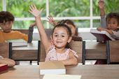 Group Cute Little Girl Student Raising Hands In Classroom School . Genius Kid Hand Up . Great Idea . poster