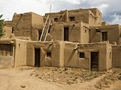 image of pueblo  - A traditional pueblo building in New Mexico. With walls formed of mud and straw the multi-story structure is representative of native American culture.  ** Note: Slight graininess, best at smaller sizes  - JPG