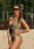 Beautiful, Gorgeous And Attractive Woman With Slim Bronzed Body In Green Stylish Bikini And Sunglass poster