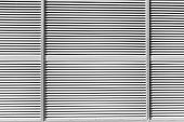 The Texture Of The Shutter Door Or Window In Light Gray Color. Metal Gates Or Shutters For Garage Or poster