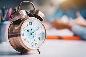 Alarm Clock On White Table.time Management And Punctuality At Work Concept.punctuality Management. poster