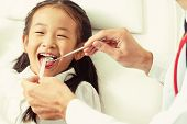 Friendly Young Dentist Examining Happy Child Teeth In Dental Clinic. Dentistry Concept. poster
