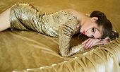 Fashion Gold Girls. A Gorgeous Young Woman In Gold Dress In Bed. Sexy And Beautiful Woman In The Bed poster