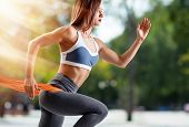 Sporty Young Woman Jogging Outdoors In The Summer. Sport Lifestyle poster