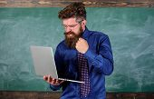Slowly Internet Annoying Him. Annoyed By Slow Internet. Hipster Teacher Aggressive With Laptop Goes  poster