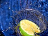 stock photo of crown green bowls  - Dropped lemon to pure water - JPG