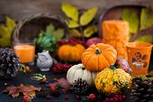 Autumnal Colorful  Pumpkins  On Candle And Fallen Leaves Background poster