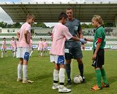KAPOSVAR, HUNGARY - JULY 21: Team captains shake hands at the VIII. Youth Football Festival U14 matc