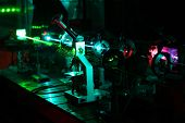 foto of diffraction  - Movement of microparticles by beams of laser in dark lab - JPG