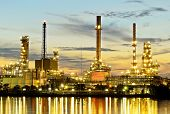stock photo of greenpeace  - The Oil refinery in morning twilight time - JPG