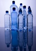 picture of plastic bottle  - Blue bottles of mineral water and water drops - JPG