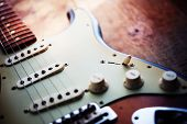 foto of surreal  - Electric guitar  on a grungy old wooden surface with impressional feeling - JPG
