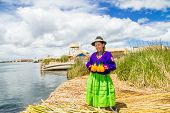 picture of mud-hut  - Hispanic woman in traditional indigenous clothing - JPG