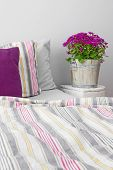 foto of pillowcase  - Modern bedroom decorated with purple flowers and cushions - JPG