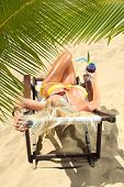 foto of bimbo  - Beautiful young woman at the summer lounge under palm trees - JPG