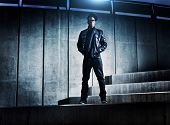 picture of swag  - cool urban african american man on distopic concrete steps - JPG