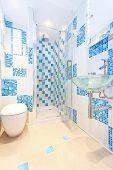 stock photo of lavabo  - Interior shot of modern and new blue bathroom - JPG