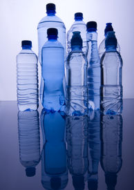 image of plastic bottle  - Blue bottles of mineral water and water drops - JPG