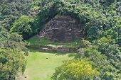 picture of atonement  - aerial view of the Jaguar Temple in Lamanai maya ruins in the tropical jungle of Belize - JPG