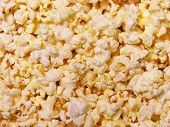 stock photo of matinee  - delicious buttery popcorn background - JPG