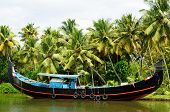 stock photo of alleppey  - India Coco trees reflection and beautifoull house boat at back waters of Kerala - JPG