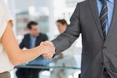 Close-up mid section of handshake to seal a deal after a business meeting