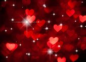 red hearts shape with sparkles as background