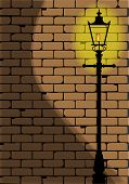 foto of edwardian  - A typical old London gaslight set against a worn brick wall with shadow - JPG