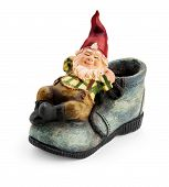 picture of gnome  - Gnome sitting on a boot isolated with clipping path - JPG