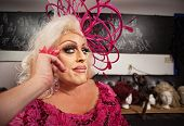 foto of drag-queen  - Drag queen in blond and pink grinning - JPG