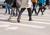 stock photo of pedestrian crossing  - pedestrians cross the street at the crossroads - JPG