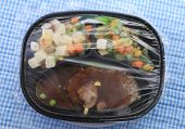 picture of frozen food  - Frozen chopped steak microwave dinner in plastic tray with potatoes and vegetable medley against blue gingham background - JPG