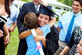 foto of hispanic  - Hispanic Student And Family Celebrating Graduation - JPG