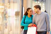 picture of mall  - Happy Couple Carrying Bags In Shopping Mall - JPG