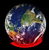 picture of courtesy  - A kitchen burner heats up the earth turned on its side from the normal perspective - JPG