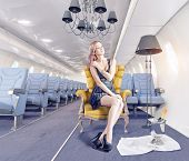 pic of legs air  - Beautiful woman in the luxury armchair in an airplane cabin - JPG