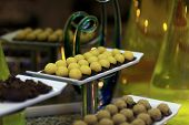 picture of cake-ball  - Tray with yellow ball cakes at the buffet - JPG